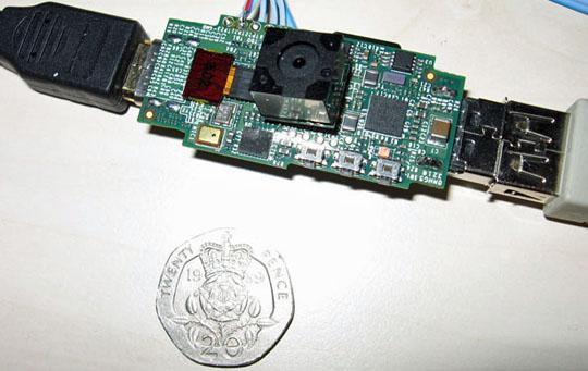 a Raspberry Pi next to a 20 pence piece