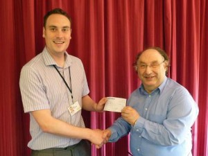 WROCC's Chris Hughes presenting Wakefield Hospice's Ben Collier with a cheque