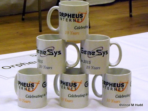 A stack of Orpheus/GeneSys anniversary mugs at RISC OS Southwest 2015