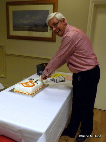 Richard Brown cutting the Orpheus Internet birthday cake at RISC OS Southwest 2015