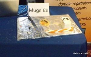 Mugs that look strangely like a (mostly eaten) cake on the Orpheus stand at Wakefield 2015