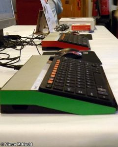 Red and green Micro One computers at London 2016