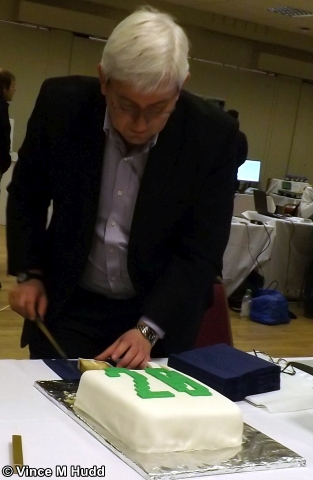 Orpheus Internet's Richard Brown cutting the cake at Southwest 2018