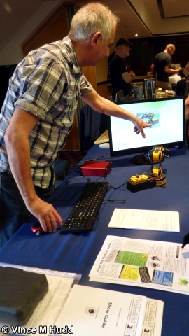 Doug Webb of the Midlands User Group points out to the robot arm that its picture is on the screen at Wakefield 2018